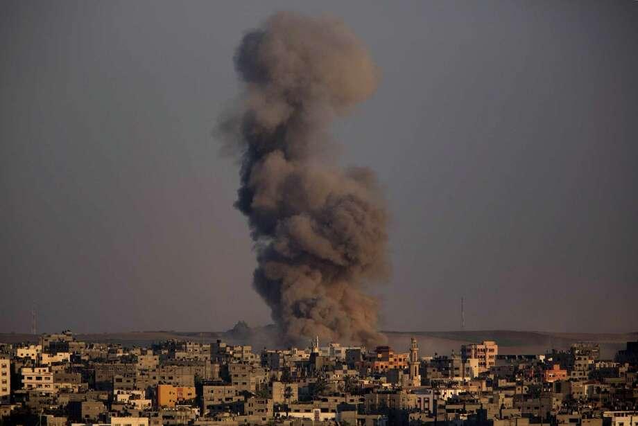 Smoke rises after an Israeli airstrike in Gaza City, Sunday, Aug. 3, 2014. (AP Photo/Dusan Vranic) Photo: Dusan Vranic, STF / AP