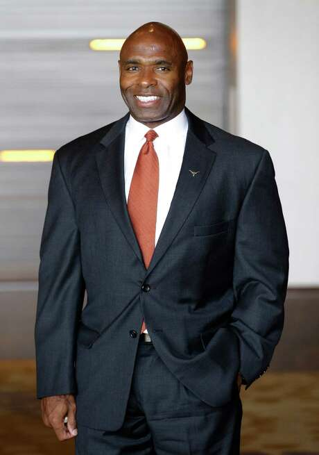 Texas coach Charlie Strong smiles for a photo during the NCAA college Big 12 Conference football media days in Dallas, Tuesday, July 22, 2014. (AP Photo) Photo: STF / AP