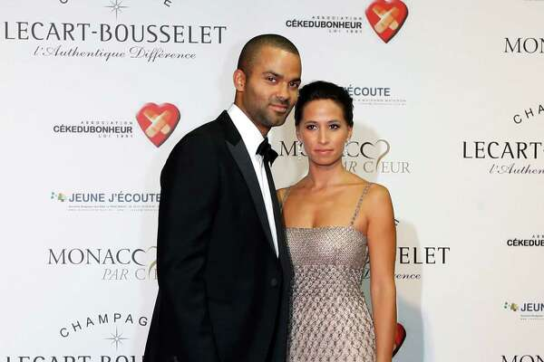 "(LtoR) French NBA and international basketball player Tony Parker and his girlfriend Axelle pose during the first edition of ""Monaco Par Coeur"", on September 22, 2012 in Monaco. AFP PHOTO / VALERY HACHE        (Photo credit should read VALERY HACHE/AFP/GettyImages)"