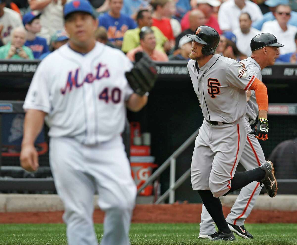 New York Mets starting pitcher Bartolo Colon (40) reacts as San Francisco Giants' Hunter Pence (8) rounds the bases after hitting a third-inning, two-run, home run off Colon in a baseball game in New York, Sunday, Aug. 3, 2014. (AP Photo/Kathy Willens) ORG XMIT: NYM106