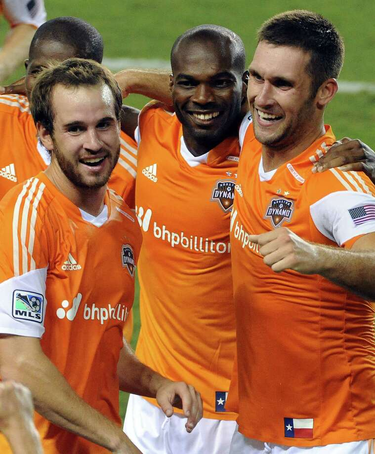 Houston Dynamo forward Will Bruin, right, celebrates his game-winning goal in the 90th minute with Brian Ownby, left, and Omar Cummings during the second half of an MLS soccer game against D.C. United, Sunday, August 3, 2014, at BBVA Compass Stadium in Houston. Photo: Eric Christian Smith, For The Chronicle / 2014 Eric Christian Smith