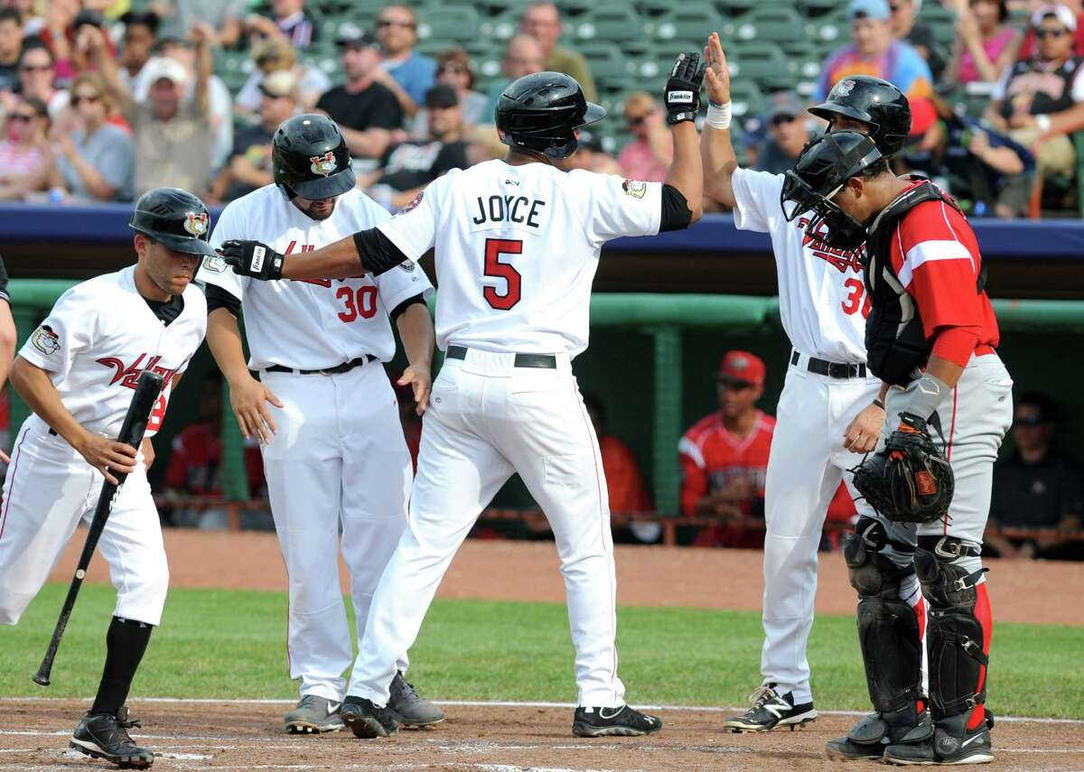 ValleyCats Terrell Joyce, #5, is congratulated by teammates as he crosses home following a first inning three-run homer during their baseball game against the Batavia Muckdogs at Joe Bruno Stadium on Sunday Aug. 3, 2014 in Troy, N.Y. (Michael P. Farrell/Times Union)