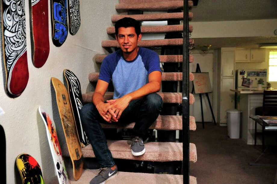 Caricature artist Hector Lopez lives in a loft apartment in Oklahoma City for less than he paid to stay in a garage near Los Angeles. Photo: NICK OXFORD, STR / NYTNS