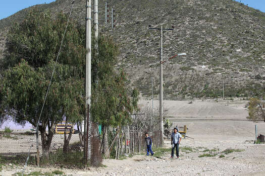 "Children arrive from school in the ejido of Bu–uelos, Coahuila, Tuesday, Feb. 18, 2014. The ejido is south of Saltillo, Mexico. The state of Coahuila has a debt of almost $3 billion, an amount that is equal to its annual budget. Dubbed the ""megadeuda,"" by the Mexican press, the blame is placed on the administration of the past governor Humberto Moreira. Photo: Jerry Lara, San Antonio Express-News / ©2013 San Antonio Express-News"