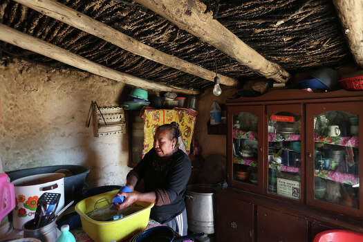 Josefina Mata Jimenez, 58, washes dishes at her house in the ejido of Bu–uelos, Coahuila south of Saltillo, Mexico, Tuesday, Feb. 18, 2014. The administration of former Governor Humberto Moreira racked up close to $3 billion in debt and as a result, the state has cut back in social services. Moreira, whose administration billed itself as, ÒEl Gobierno de la Gente,Ó or peopleÕs government, implemented various program such as the ÒpeopleÕs card,Ó ÒpeopleÕs uniforms,Ó and ÒpeopleÕs shoesÓ. The cards were like food stamps, given out monthly, with dollar amounts ranging from $15 to $50. It was the only benefit that made it to the ejido and Mata said, ÒWe lost a lot of benefits from the cardÓ. Photo: Jerry Lara, San Antonio Express-News / ©2013 San Antonio Express-News