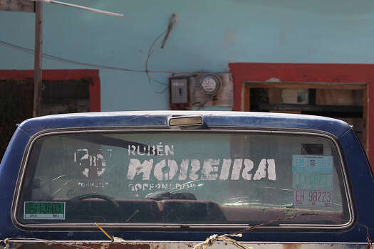 A truck in the ejido of Agua Nueva, Coahuila has a political decal endorsing the present Coahuila Governor Ruben Moreira, Tuesday, Feb. 18, 2014. Moreira is the brother of the former governor, Humberto Moreira, who was in office from 2005-2011. After his departure from office, it was revealed to the public that the administration had incurred an almost $3 billion debt. The amount is equal to the stateÕs annual budget. Photo: Jerry Lara, San Antonio Express-News / ©2013 San Antonio Express-News