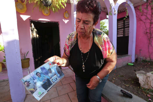 Yolanda Rocamontes, 70, enrapturedly recalls the tenure of former governor Humberto Moreira, while speaking with media outside her house in the Colonia Centenario in Saltillo, Mexico, Tuesday, Feb. 18, 2014. During Moreira tenure, the state racked up nearly $3 billion in debt. She blames it on unscrupulous members of MoreiraÕs administration. An ardent Institutional Revolutionary Party, (PRI), member, Rocamontes is the neighborhood Òlideraza,Ó or female party leader, whose job is to hand out government subsidies such as blankets and food. A larger part of her job is to get people to the polls on election day. Photo: Jerry Lara, San Antonio Express-News / ©2013 San Antonio Express-News