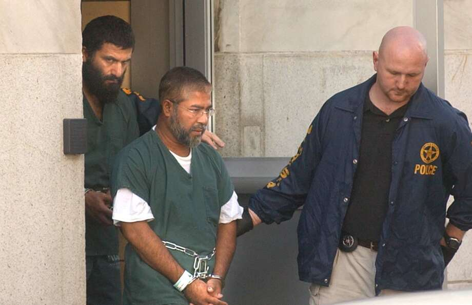 Yassin Aref, left, and Mohammed M. Hossain are escorted from U.S. Distict Court in August 2004. Supporters will mark the 10th anniversary of their arrested on Monay with a rally, march and short play. (File photo) Photo: STEVE JACOBS / ALBANY TIMES UNION