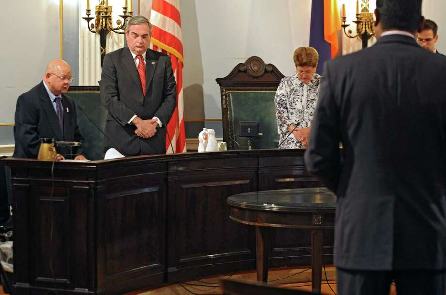 Rev. Moonhawk River Stone, left, an interfaith minister, says a prayer before the start of the City Council meeting at Schenectady City Hall on Monday, July 28, 2014 in Schenectady, N.Y. The Supreme Court ruled allowing prayer before meetings in municipalities. (Lori Van Buren / Times Union) Photo: Lori Van Buren / 00027829A