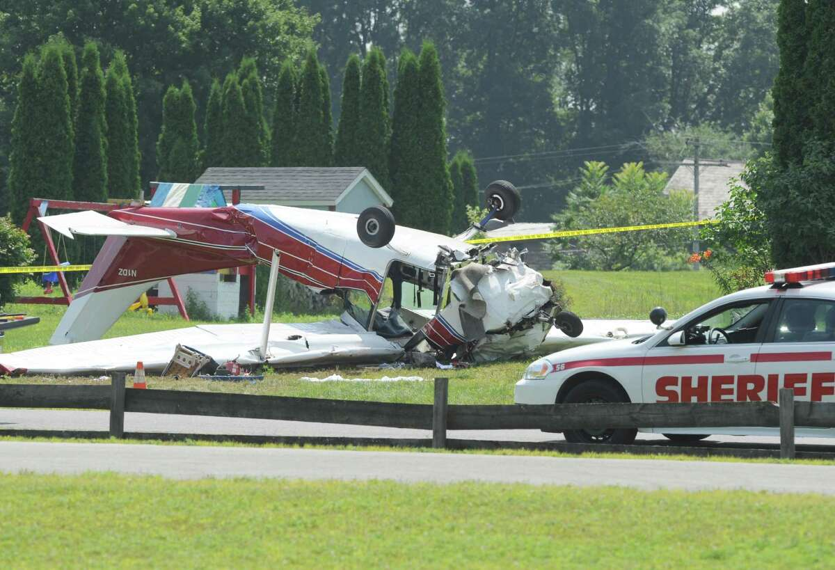 The scene of a fatal plane crash at 303 Brownviile Road on Sunday Aug. 3, 2014 in Gansevoort, N.Y. (Michael P. Farrell/Times Union)