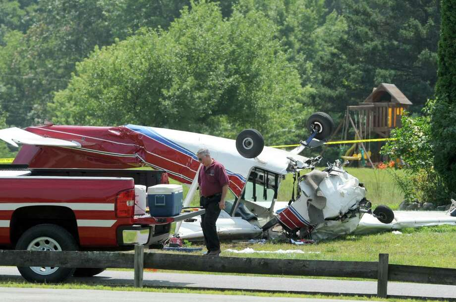 The scene of a fatal plane crash at 303 Brownviile Road  on Sunday Aug. 3, 2014 in Gansevoort, N.Y.  (Michael P. Farrell/Times Union) Photo: Michael P. Farrell