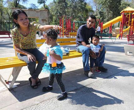 Factory worker Zenaido Guerrero, wife Jennifer Estefania, daughter Arlett and son Patricio de Jesus, spend some time in Saltillo's Alameda Zaragoza Park. Photo: Photos By Jerry Lara / San Antonio Express-News / ©2013 San Antonio Express-News