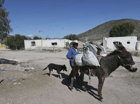 Arturo Mata, 70, carries his groceries on a burro in the 