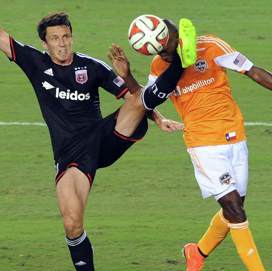 D.C. United's Lewis Neal, left, gives DaMarcus Beasley a rude welcome back to MLS. Photo: Eric Christian Smith, Freelance / 2014 Eric Christian Smith