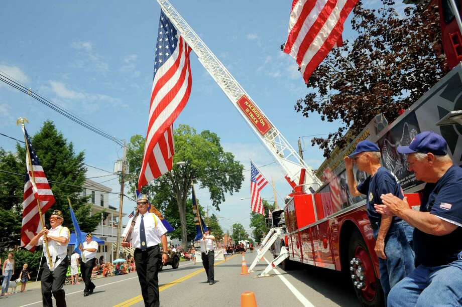 Members of the American Legion Old Saratoga Post 278 leads the 20th annual Turning Point Parade on Sunday Aug. 3, 2014 in Schuylerville, N.Y. The event marks the 1777 surrender of the British, often considered the American Revolutiona€™s a€œturning point.a€ (Michael P. Farrell/Times Union) Photo: Michael P. Farrell / 00027929A