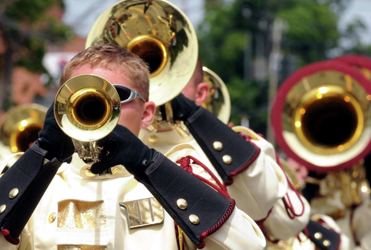 Taylor Conrad plays trumpet with Windsor Regiment Drum and Buglefrom New Jersy as they march in the 20th annual Turning Point Parade on Sunday Aug. 3, 2014 in Schuylerville, N.Y. The event marks the 1777 surrender of the British, often considered the American Revolutiona€™s a€œturning point.a€ (Michael P. Farrell/Times Union)
