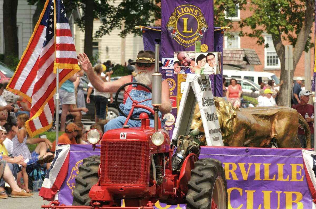 Bernie Wood with Lions International drive a tractor in the 20th annual Turning Point Parade on Sunday Aug. 3, 2014 in Schuylerville, N.Y. The event marks the 1777 surrender of the British, often considered the American Revolutiona€™s a€œturning point.a€ (Michael P. Farrell/Times Union)