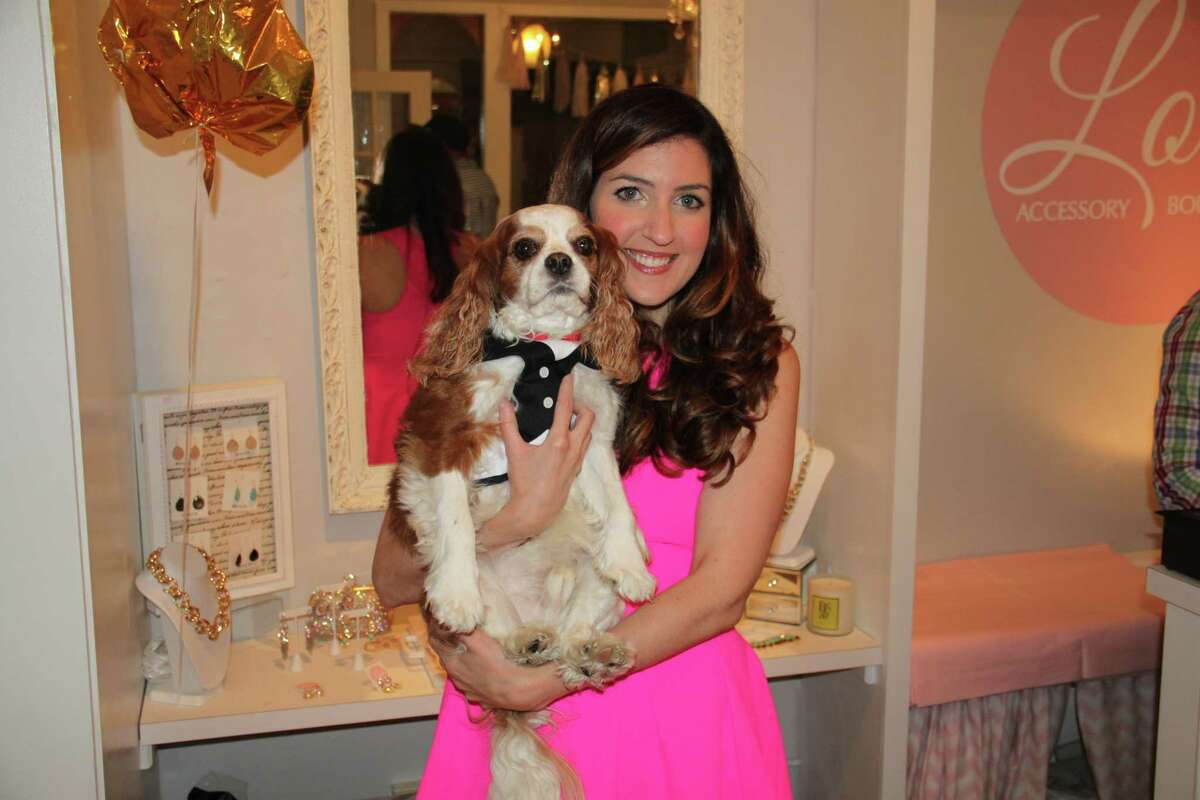 Megan Druckman, owner of Lola Accessory Boutique, poses with her rescue dog Charlie at the shop's first anniversary party on Friday, 6/13. A portion of the proceeds from the evening's sales were donated to Saratoga-based Homes for Orphaned Pets Exist (H.O.P.E.) in honor of Charlie and Animal Rights Awareness Week (June 19-25). (Sarah Child)