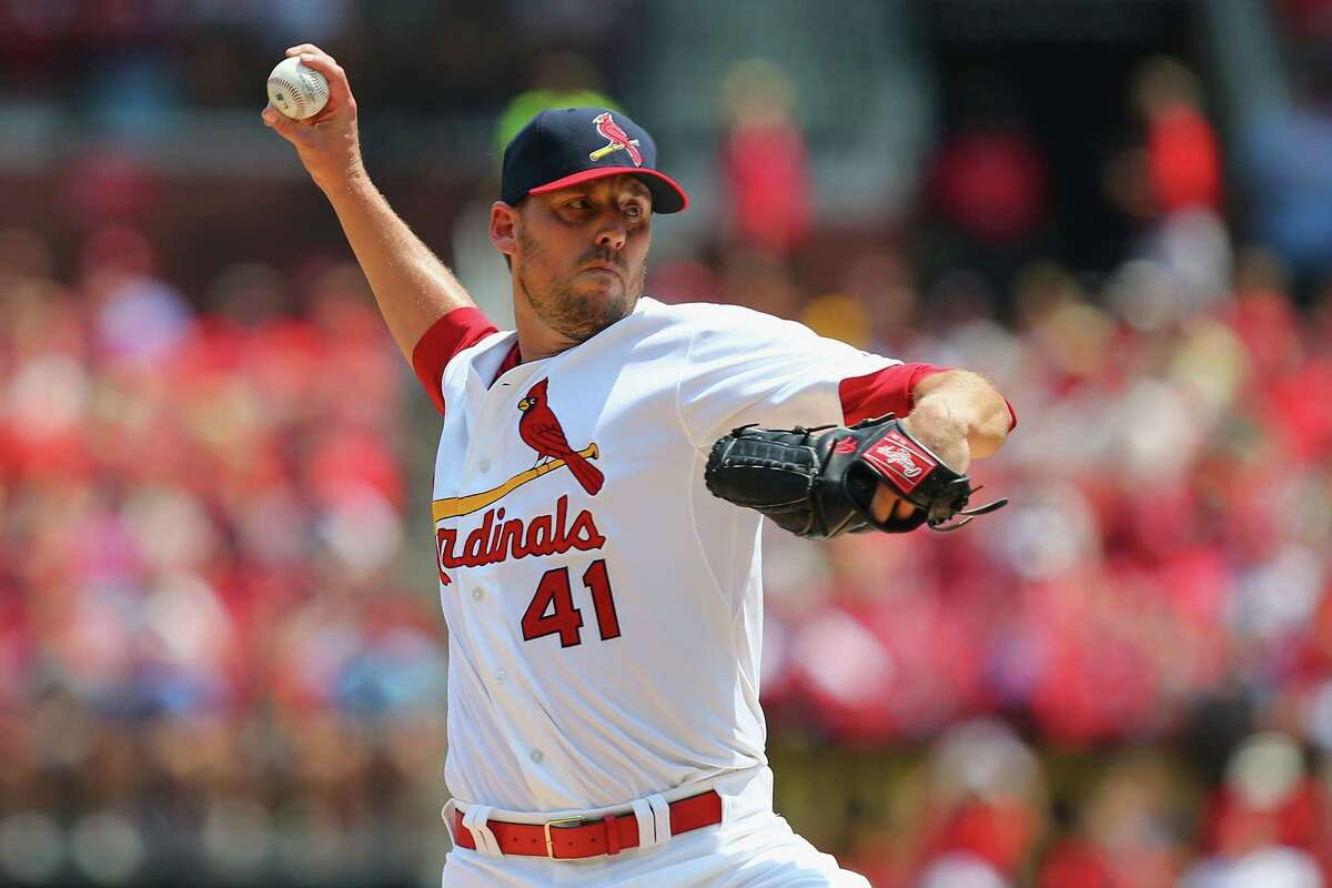 ST. LOUIS, MO - AUGUST 3: Starter John Lackey #41 of the St. Louis Cardinals pitches against the Milwaukee Brewers in the first inning at Busch Stadium on August 3, 2014 in St. Louis, Missouri. (Photo by Dilip Vishwanat/Getty Images) ORG XMIT: 477587395