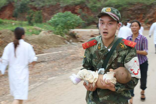 Zhaotong China  city photos gallery : ZHAOTONG, CHINA AUGUST 03: CHINA OUT Armed police rescue the ...