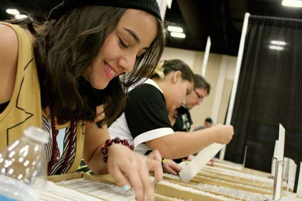Fans and superfans attend at Wizard World San Antonio Comic Con on  Sunday, Aug. 3, 2014, at the Henry B. Gonzalez Convention Center.
