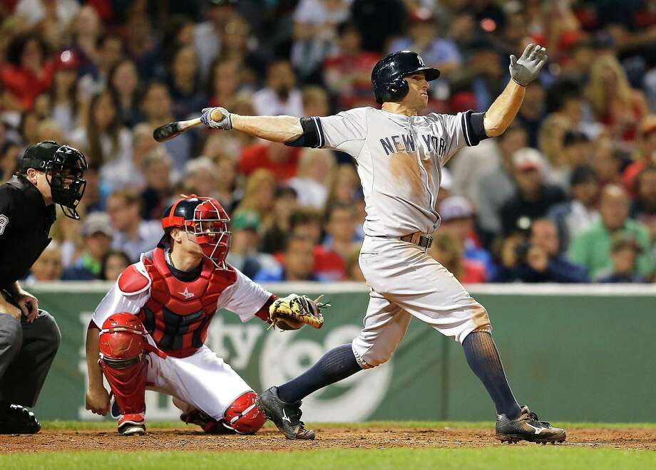BOSTON, MA - AUGUST 3:  Brett Gardner #11 of the New York Yankees connects for a home run in the sixth inning against the Boston Red Sox at Fenway Park on August 3, 2014 in Boston, Massachusetts. (Photo by Jim Rogash/Getty Images) ORG XMIT: 477587331 Photo: Jim Rogash / 2014 Getty Images