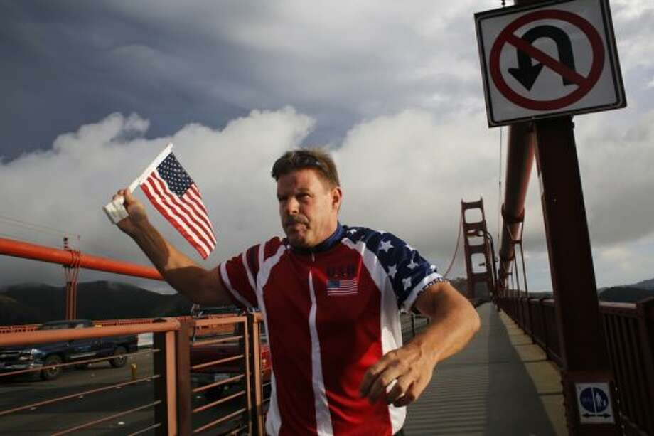 """Flag Man,"" Rob Peterson, 52, prepares to turn around after walking north to south on the Golden Gate bridge."