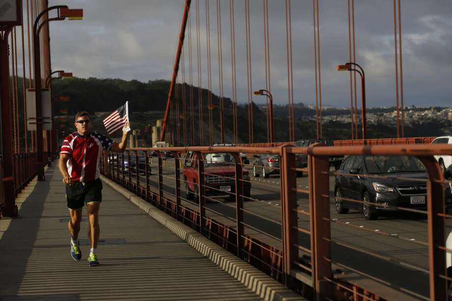 """Flag Man,"" Rob Peterson, 52, starts his return to the north side of the Golden Gate Bridge. Photo: Mike Kepka"