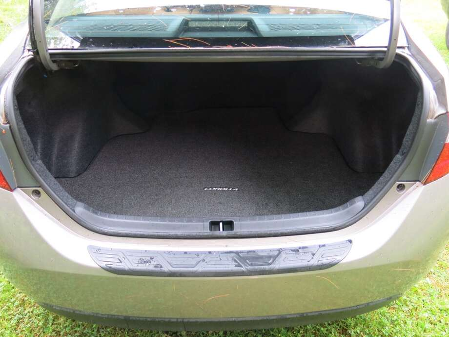 The Corolla's trunk has 13 cubic feet of cargo space, which is not much less than that of a midsize sedan.