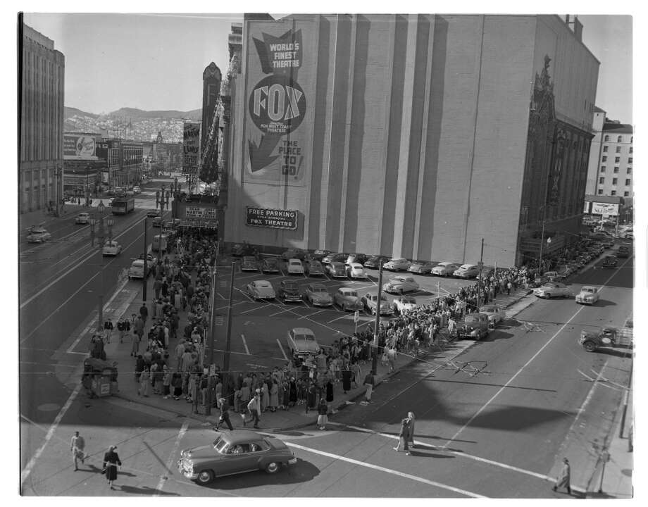 The San Francisco Fox Theatre, seen here on Feb. 12, 1952, with a crowd in line awaiting the Jerry Lewis - Dean Martin show. Photo: Joe Rosenthal, The San Francisco Chronicle
