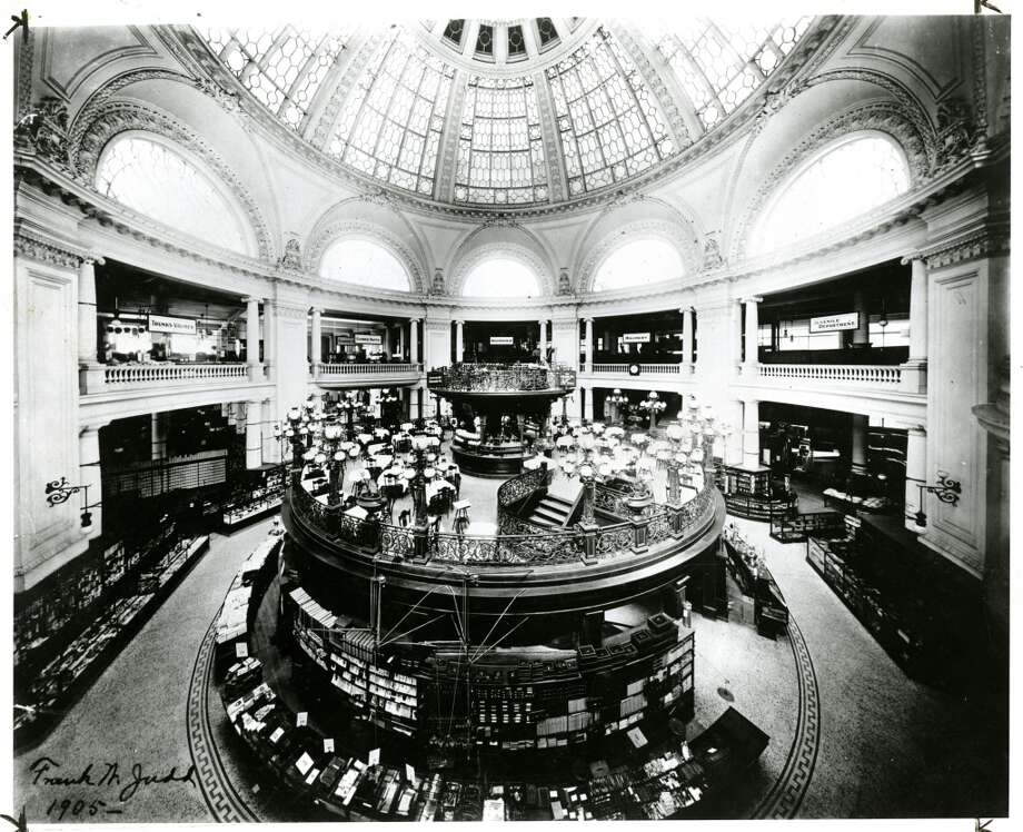 Getting all dressed up to go downtown, such as for a shopping trip to the Emporium. Pictured: The store's bandstand on the street floor in 1905. The   Market Street Emporium closed in 1996. Suggested by user 'telhinative.' Photo: Unknown