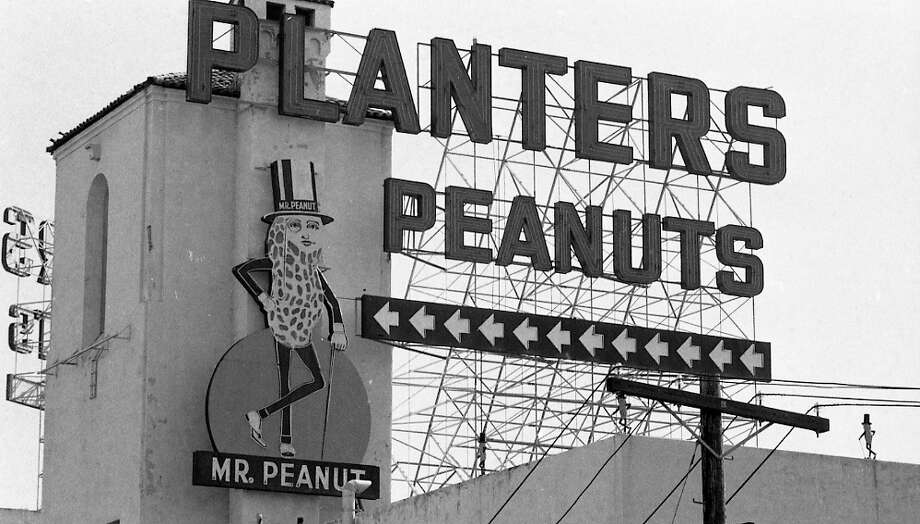SFGate user 'stevyd' misses the Mr. Peanut statues on top of the Planters Peanut building at Bayshore and Paul Avenues, seen here on July 14, 1976. Photo: Joe Rosenthal, The Chronicle / ONLINE_YES