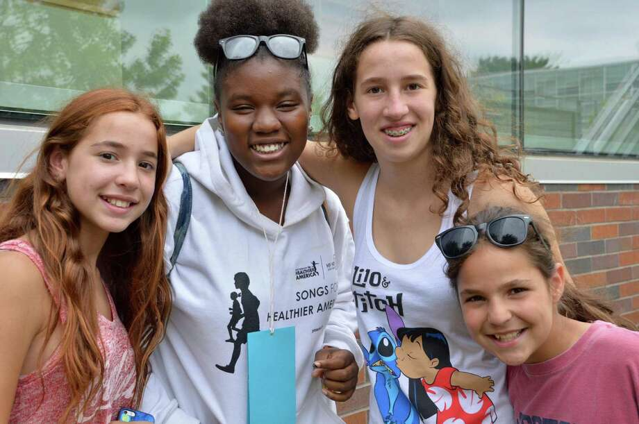 "A ""second"" family was reunited Saturday with arrival of Fresh Air Fund visitors to the area, from left: Hannah Greene, 13, of Weston; Shniyah Welch, 14, of Brooklyn, N.Y., Taylor Greene, 14, and Shea Greene, 10. Photo: Jarret Liotta / Fairfield Citizen"