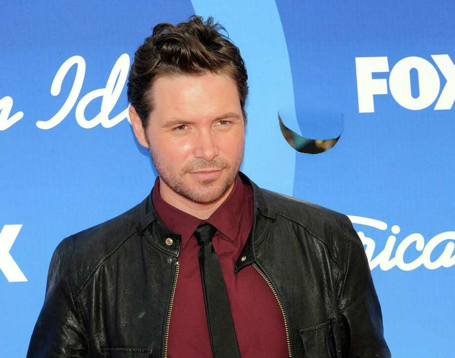 """FILE - In this May 16, 2013, file photo, Michael Johns arrives at the """"American Idol"""" finale at the Nokia Theatre at L.A. Live in Los Angeles. Johns, who appeared in season 7 of the hit Fox singing competition and was voted off in an eighth-round stunner, has died. He was 35. The network and his family released statements Saturday, Aug. 2, 2014, confirming the Australian-born singer's death. The Hollywood Reporter says Johns died Friday. A cause of death wasn't immediately available. (Photo by Chris Pizzello/Invision/AP, File) Photo: Chris Pizzello, Chris Pizzello/Invision/AP / Invision"""
