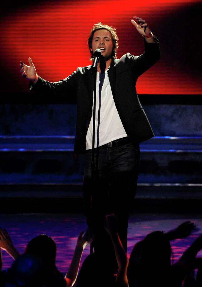 "Contestant Michael Johns performs ""Across the Universe"" by The Beatles live on American Idol March 11, 2008 in Los Angeles, California. The top 12 contestants perform in front of the American Idol judges on Fox. Photo: R Mickshaw/American Idol 2008, Getty Images For FOX / 2008 Fox"