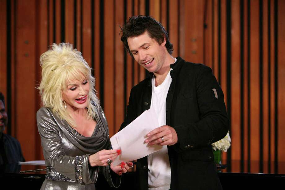 American Idol contestant Michael Johns rehearses in the studio with country singer Dolly Parton on March 29, 2008 in Los Angeles, California. Photo: Michael Becker, Getty Images For FOX / 2008 Michael Becker
