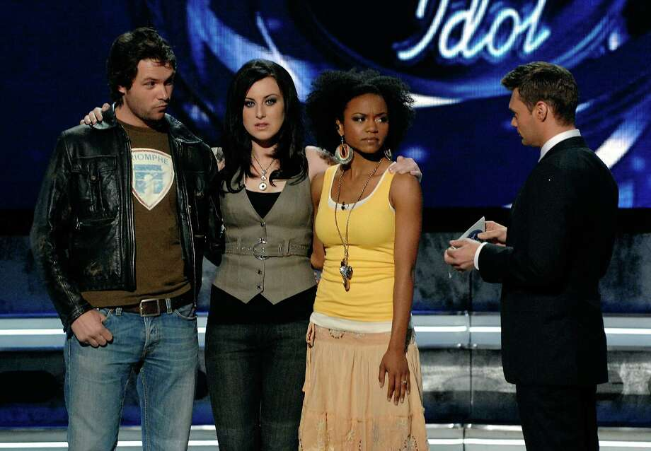 Contestants Michael Johns (from left), Carly Smithson and Syesha Mercado with Host Ryan Seacrest while finding out who will be eliminated from the competition during live show of American Idol April 10, 2008 in Los Angeles, California. Photo: R Mickshaw/American Idol 2008, Getty Images For FOX / 2008 Fox