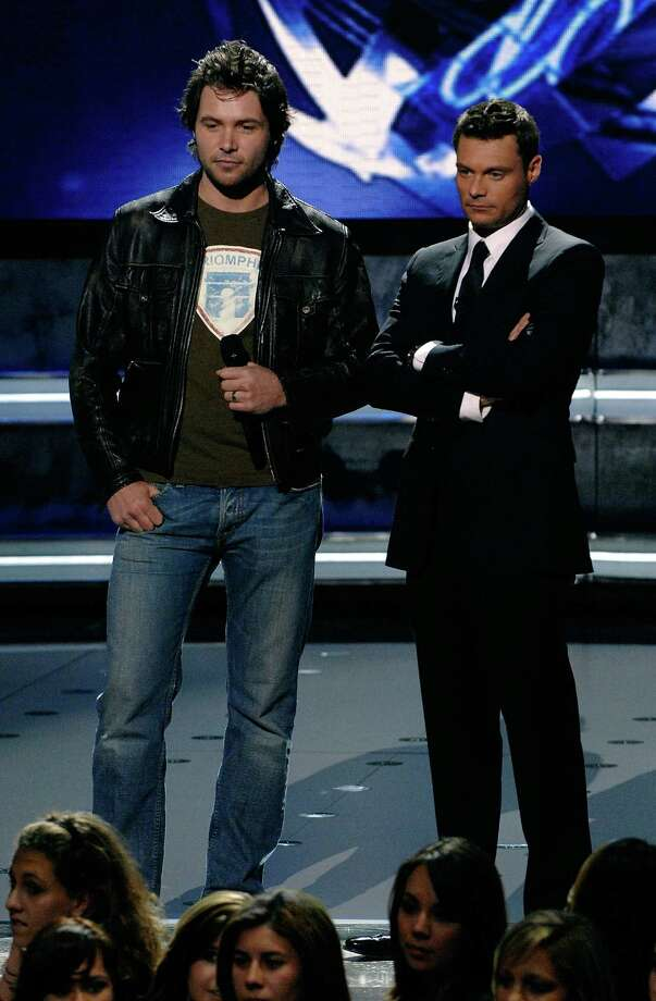 Contestant Michael Johns with Host Ryan Seacrest after being eliminated from the competition during live show of American Idol April 10, 2008 in Los Angeles, California. Photo: R Mickshaw/American Idol 2008, Getty Images For FOX / 2008 Fox