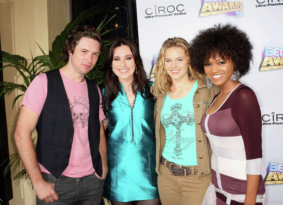 American Idol season 7 finalists Michael Johns (from left), Carly Smithson, Kristy Lee Cook and Syesha Mercado arrive at the 2008 BET Awards after party held at the The Roosevelt Hotel on June 24, 2008 in Hollywood, California. Photo: Frederick M. Brown, Getty Images / 2008 Getty Images