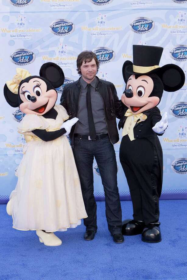 Michael Johns, season 7 finalist, walks on the red carpet for the grand opening of the American Idol Experience at Disney's Hollywood Studios In Walt Disney World on February 12, 2009 in Lake Buena Vista, Florida. Photo: Matt Stroshane, Getty Images / 2009 Matt Stroshane