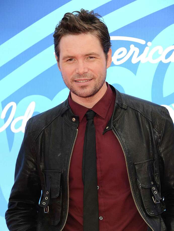 Singer Michael Johns attends the American Idol 2013 finale at Nokia Theatre L.A. Live on May 16, 2013 in Los Angeles, California. Photo: Jason LaVeris, FilmMagic Via Getty Images / 2013 Jason LaVeris