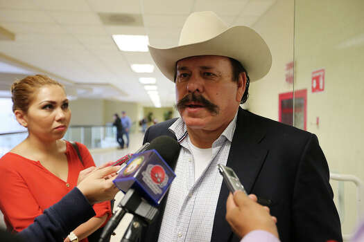 Millionaire rancher and coal mine owner Armando Guadiana Tijerina, talks with the media before a discovery hearing in Saltillo, Mexico, Thursday, Feb. 20, 2014. The former governor of Coahuila, Humberto Moreira, has filed defamation lawsuit against Guadiana. The rancher ran a series of ads in local papers blaming the governor for the almost $3 billion in debt incurred during his administration. The rancher has countersued the former governor for associating him with narco-gangs in the area. Photo: Jerry Lara, San Antonio Express-News / ©2013 San Antonio Express-News
