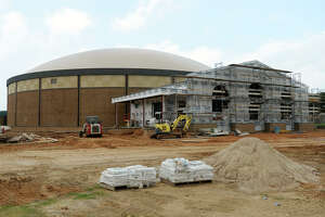 Construction continues on the FEMA Dome and Performing Arts Center in Lumberton on Friday. School districts around the area are making use of bonds to work on school properties and new projects. Photo taken Friday 8/1/14 Jake Daniels/@JakeD_in_SETX