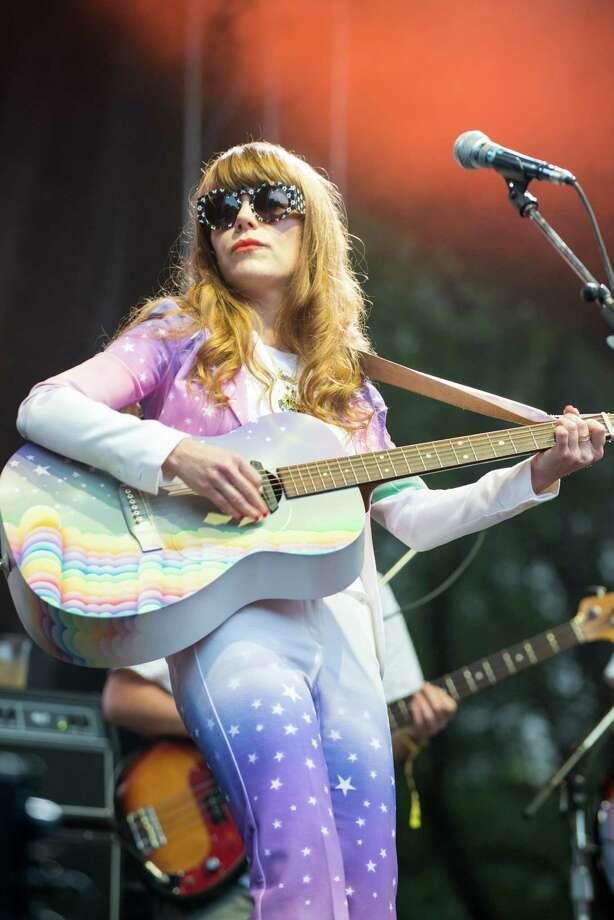 "Rainbows and LollipopsNothing says ""one with the world"" like a painted a rainbow guitar and a starry suit.   Photo: Gaelle Beri, Getty / 2014 Gaelle Beri"