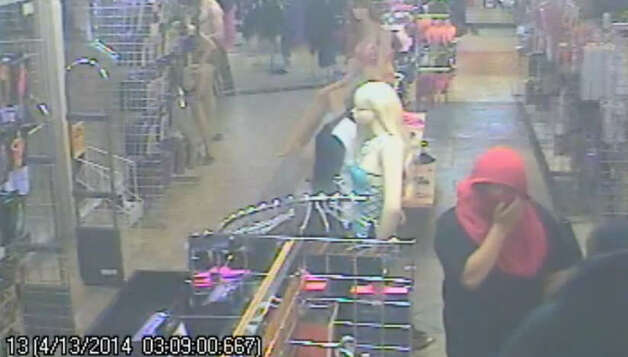 Three Houston teens – ages 16, 15 and 15 – have been arrested and charged with armed robbery for breaking into and shooting up the Katz Boutique adult novelty shop on North Freeway. The bumbling crooks trip over one another on the way out, causing the gun to accidentally fire, wounding a store mannequin and shattering the front door. | Houston Police Department Photo: Houston Police Department