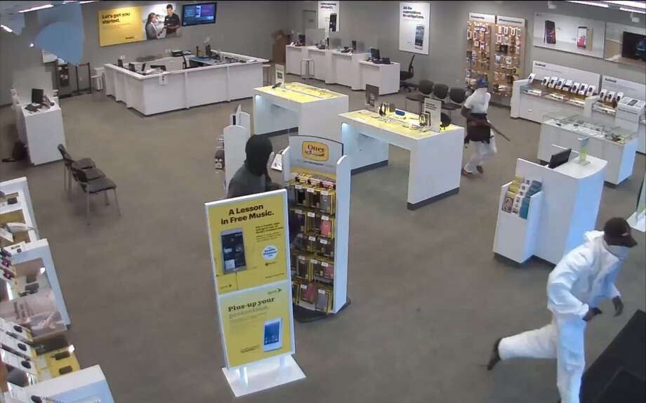 CELLPHONE STORE ROBBERY, PART 1:Houston police are searching for three masked gunmen who robbed a Sprint store at gunpoint on July 17. Investigators believe they may be the same men who committed a similar armed robbery of a Harris County T-Mobile store on July 24, making off with approximately $30,000 in cellphones. (Houston Police)RELATED:Gun-toting trio robs SW Houston cell store Photo: Houston Police Department