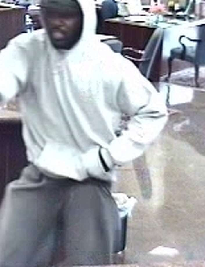 MONTROSE BANK ROBBERY:A surveillance photo of the Thursday morning robbery at an International Bank of Commerce branch in Montrose.RELATED: Armed robbers strike Montrose bank Photo: FBI