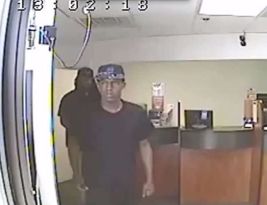 LOAN STORE ROBBERY: Houston police robbery investigators have released surveillance video and photos of two suspects wanted in a robbery of the EZ Money Loan Services  at 7000 North Freeway service road about 12:50 p.m. on May 24.  The suspects are described only as black males.  One was armed with a semiautomatic pistol.  He is about 5 feet 9 inches tall, weighs about 170 pounds, was wearing a black T-shirt and has several tattoos on his face.  The second suspect is about 5 feet 11 inches tall, 170 pounds and has long braids, a mustache and goatee.  The suspect was wearing a black T-shirt and Chicago Bulls cap.RELATED: Man asks for loan, robs Houston loan store Photo: Houston Police Department