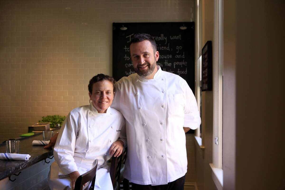 Traci Des Jardins poses for a portrait with Chef Robbie Lewis at her new restaurant The Commissary in San Francisco, CA, Thursday, July 24, 2014.