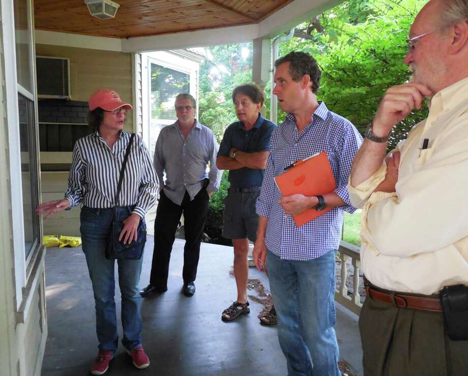 Selectman Helen Garten, chair of the Kemper-Gunn Advisory Group, gets ready to lead a tour of the historic house Monday morning. Plans are to re-purpose the structure and relocate it from Church Lane to the nearby Baldwin parking lot. With Garten are (from left) Matt Mandell, Representative Town Meeting and advisory group member;  resident Don Bergmann; Morley Boyd, a member of the Downtown Steering Committee, and Joseph Strickland, advisory group member and chairman of the town's Public Site and Building Committee. Photo: Anne M. Amato / westport news